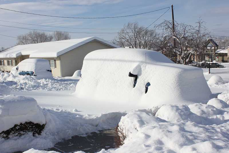 by: SUSAN MATHENY - A car remained buried in snow on Monday, after a snowstorm that started Friday.