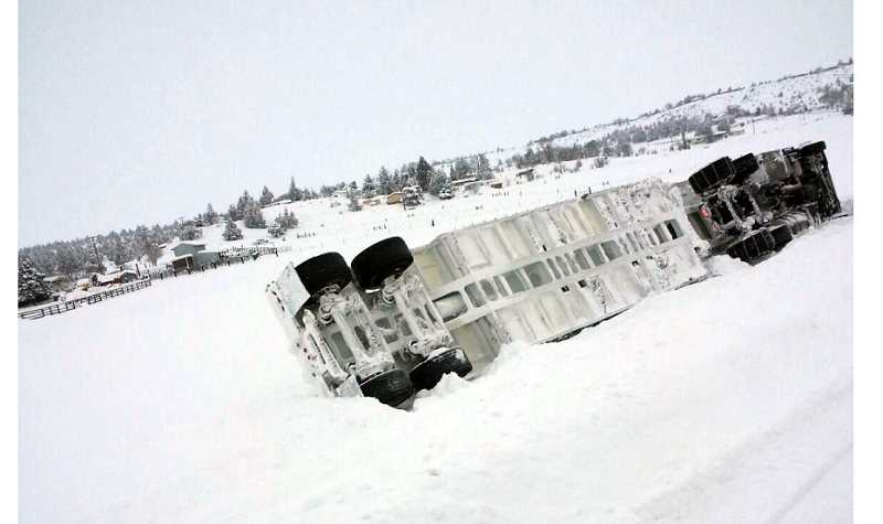 by: SANTANA LANTZ - One of the more dramatic of several snow-caused accidents sent this semi off U.S. Highway 97 just east of Madras. The driver was transported to St. Charles Madras with minor injuries, according to a report from the Jefferson County Sheriff's Office.