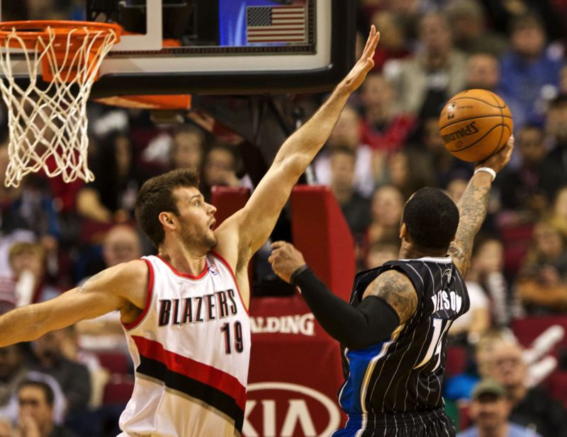 by: TRIBUNE PHOTO: JAIME VALDEZ - Joel Freeland, challenging a shot by Orlando guard Jameer Nelson, will be out of the Blazers' rotation for a while because of injury.