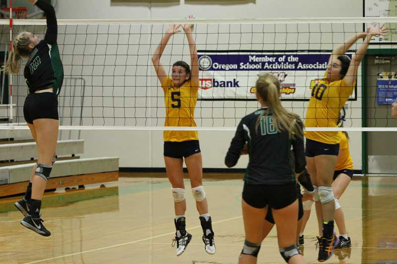 by: KORY MACGREGOR - Canby setter Abby MacGregor (5), shown against Jesuit this past season, will continue her volleyball career at George Fox University in Newberg.