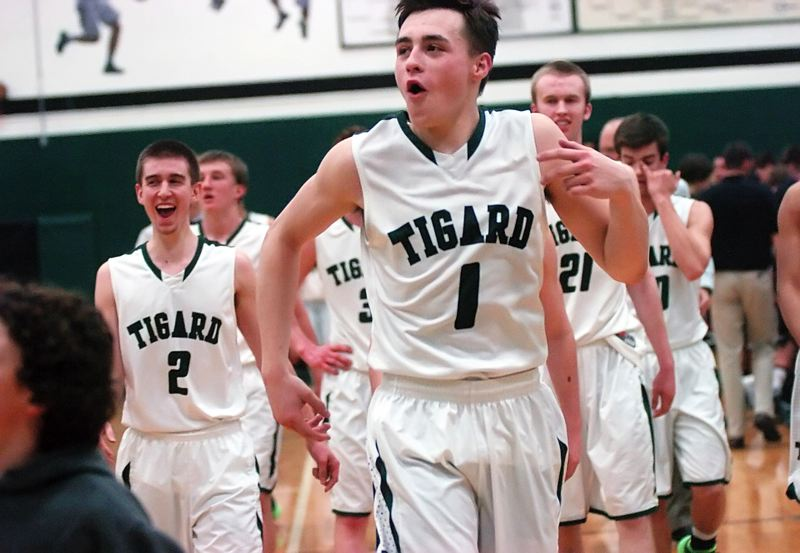 by: DAN BROOD - GOOD TIMES -- Tigard senior Bryan Berg, who scored a game-high 20 points, celebrates with his teammates following the 71-43 win over rival Tualatin.