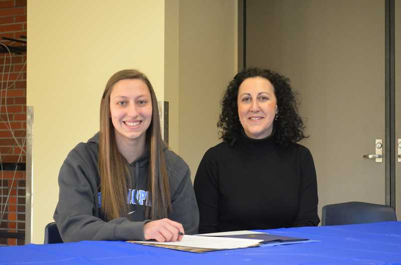 by: JEFF GOODMAN / PAMPLIN MEDIA GROUP - Bess Kitzmiller, shown with her mother, Peggy, takes part in a Signing Day ceremony Feb. 5 at Wilsonville High School. The goalkeeper was accepted at Johns Hopkins University but did not ink an official letter of intent because Division III schools do not offer athletic scholarships.