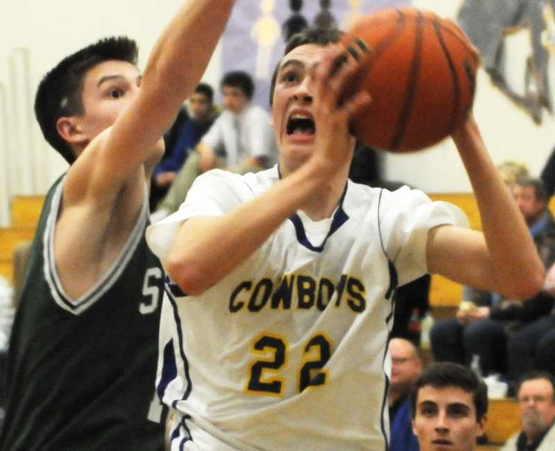 by: LON AUSTIN/CENTRAL OREGONIAN - Lon Austin/central Oregonian Seth Kessi goes up for two of his 16 points in the Cowboys, 52-42, loss to the Summit Storm on Tuesday. Kessi was one of three Cowboys in double figures in the contest.