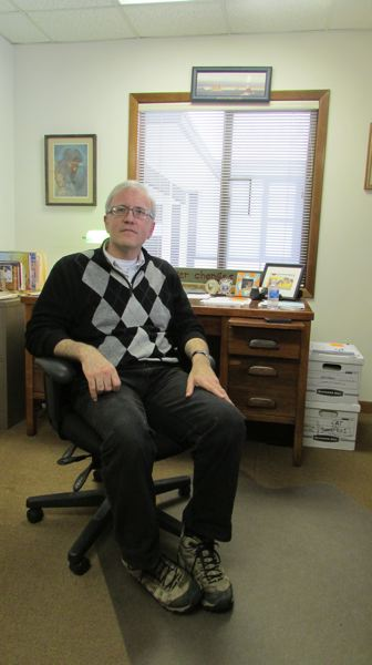 by: SPOTLIGHT PHOTO: MARK MILLER - Pastor David Hutchinson in his new office at Plymouth Presbyterian Church in St. Helens on Tuesday, Feb. 11. Hutchinson said he was attracted to the church because he believes it shares his focus on mission work and outreach.