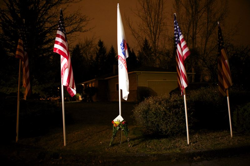 by: VALLEY TIMES PHOTO: JAIME VALDEZ - A memorial included flags and flowers outside the Pelham home in Beaverton Thursday, one day after the family was told 22-year-old John A. Pelham was killed in Afghanistan.