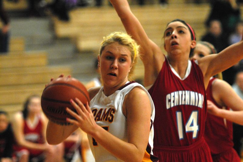 by: PAMPLIN MEDIA GROUP: DAVID BALL - Central Catholic center Jerusha Paine goes up for a shot in front of Centennial's Gabbi Schmitt during the Rams' 49-44 win Thursday night.