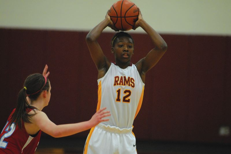 by: PAMPLIN MEDIA GROUP: DAVID BALL - Rams point guard Zharia Hale makes a pass near midcourt.