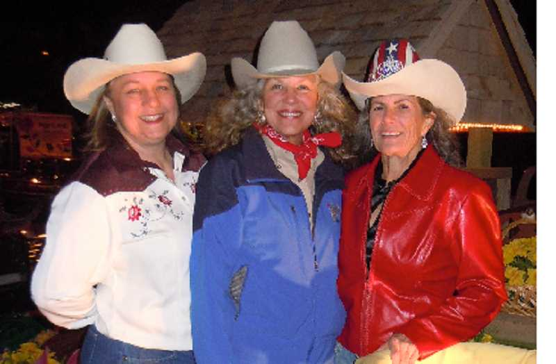 by: SUBMITTED - Former Molalla Buckeroo Royal, Zuber, in red jacket, poses withother royals.