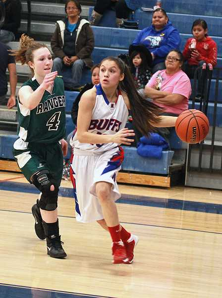 by: BILLY GATES/THE PIONEER - Madras point guard Mariah Stacona drives to the hoops past an Estacada defender during the Buffs' win against the Rangers.
