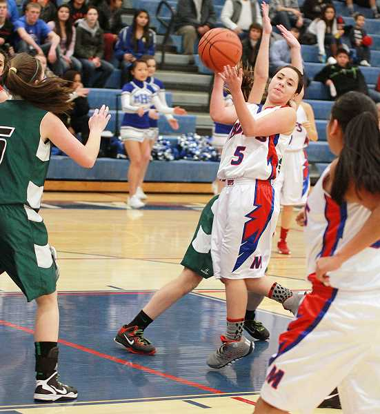by: BILLY GATES/THE PIONEER - Madras guard Vanessa Esquivel tries to pass the ball out of the paint during the Buffs' win against the Rangers.