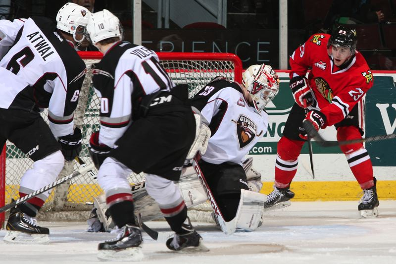 by: COURTESY OF CHRIS RELKE/VANCOUVER GIANTS - Portland Winterhawks forward Dominic Turgeon (right) looks for an opening from close range against Vancouver during Saturday's road game.