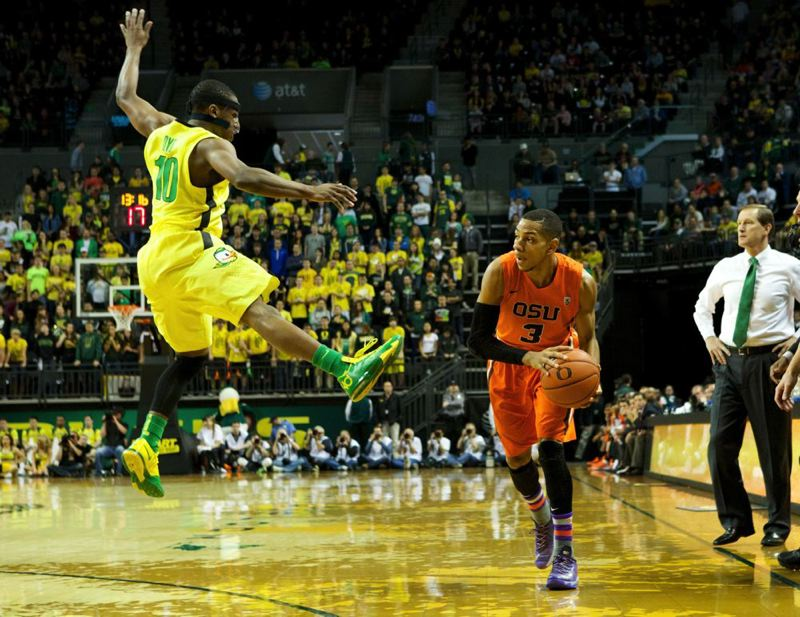 Beavers guard Hallice Cooke catches Oregon's Johnathan Loyd in the air.