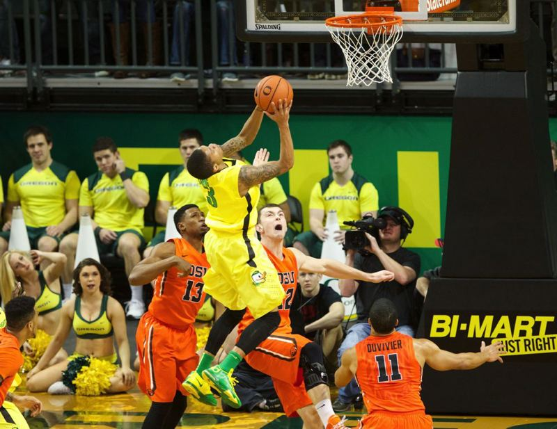 Joseph Young of Oregon is fouled by Oregon State's Angus Brandt.
