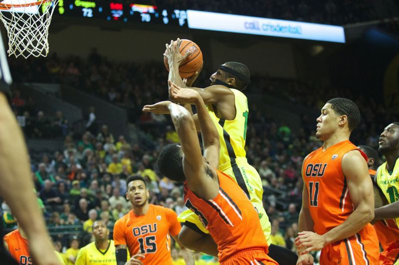 Ducks guard Johnathan Loyd drives for a shot against Oregon State guard Langston Morris-Walker.
