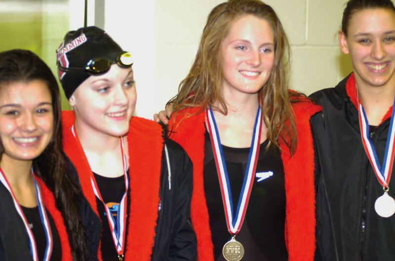 by: SANDY POST: PARKER LEE - Sandys 200-medley relay team, Zayna Salveter, Shelbi Hayzlett, Hannah Gupton and Asha Gatchell stand atop the awards podium Friday.