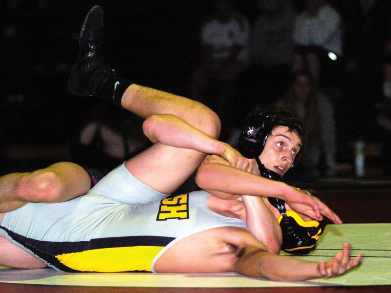 by: SANDY POST: PARKER LEE - Sandys Blane Hays checks the clock on his way to a first-round pin at 145 pounds.