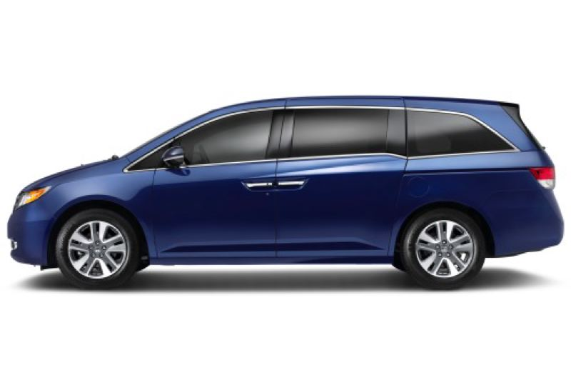by: AMERICAN HONDA MOTOR COMPANY, INC. - The 2014 Honda Odyssey features a unique built-in vacuum cleaner.