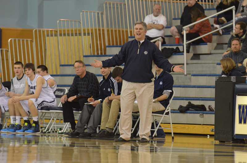 by: JEFF GOODMAN - Wilsonville boys basketball coach Chris Roche wants clarification on a call Feb. 11 during a home game against Sandy. The Wildcats prevailed to stay in the race for a league title.