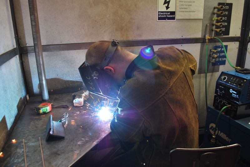 by: PHOTO COURTESY: CCC - A student takes part in a welding competition at last year's Skills Day event.