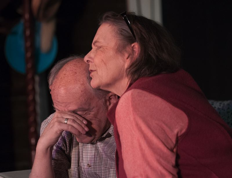 by: SPOKESMAN PHOTO: JOSH KULLA - On Golden Pond is a story of love, loss, family and the ties that sometimes grow fragile. Here, Ethel (Alexa MacDonald) comforts Norman as he tries to confront his own mortality.