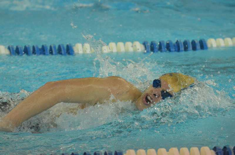 by: JEFF GOODMAN / PAMPLIN MEDIA GROUP - Canby junior Ryan Cully took second place in the boys 50-yard freestyle finals at the Three Rivers League championships Feb. 15 at the Lake Oswego District Pool. He won a district title in the event last year.