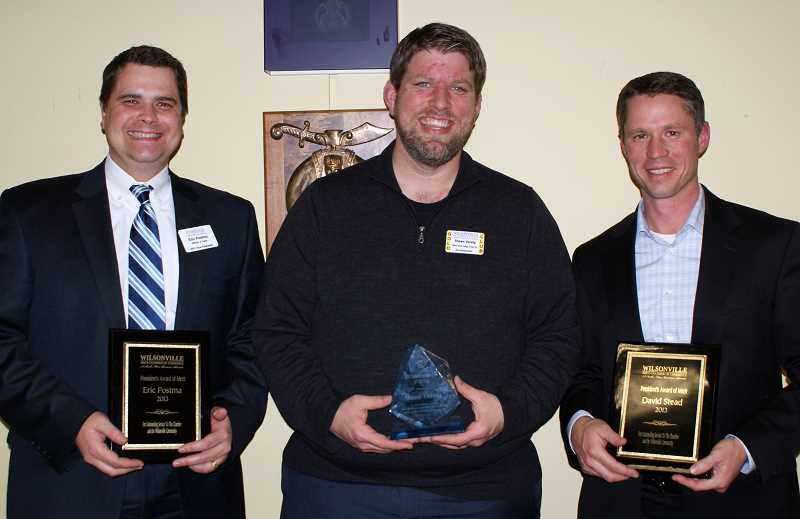 by: SUBMITTED PHOTO - Eric Postma, Shawn Varwig and David Stead all received awards during the Wilsonville Area Chamber of Commerce Winter Bash and Auction.