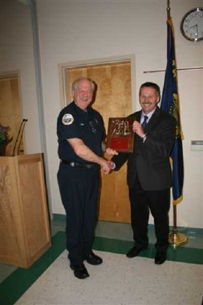 by: WOODBURN FIRE DISTRICT - Ulrich Reich receives the Chief's Award for Community Service from Chief Paul Iverson.