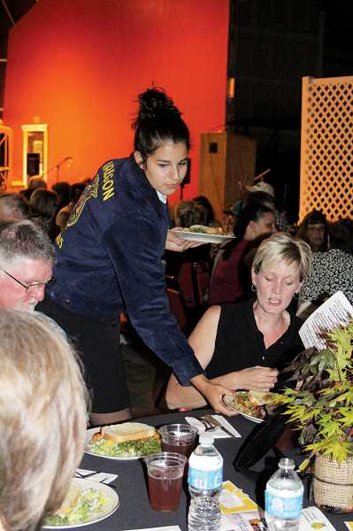 by: KAREN LANG - Gervais FFA member Tiana Jaramillo help serve dinner to guests at last years FFA banquet. Along with helping with the presentations, the Gervais FFA members assist in serving and setting up the event.
