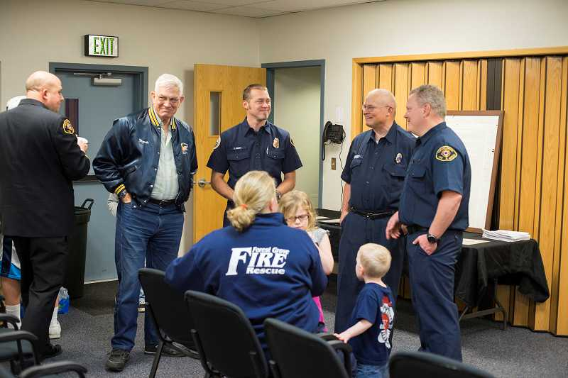 by: NEWS-TIMES PHOTO: CHASE ALLGOOD - Old and new firefighters -- including former battalion chief Marvin Wright and Bob and Victor Haney -- mill around inside the Forest Grove Fire & Rescue station as they shared stories and paid tribute to 120 years of the departments operation in town.