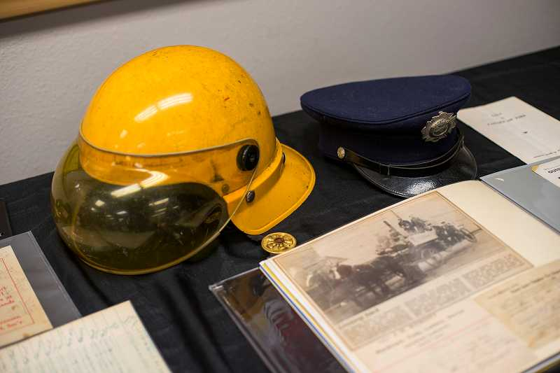 by: NEWS-TIMES PHOTO: CHASE ALLGOOD - The yellow 1960s-era helmet (left) belonged to retired FGF&R captain Dwight Lanter, and the blue felt cap (right) is that of Walt Vandervelden, the departments first paid firefighter. Vandervelden was elected chief in 1928 and retired in 1963.