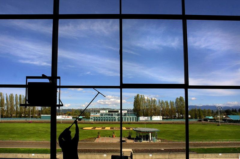 by: TRIBUNE FILE PHOTO: JIM CLARK - The windows are cleaned before a night of racing in Fairview in 2004.