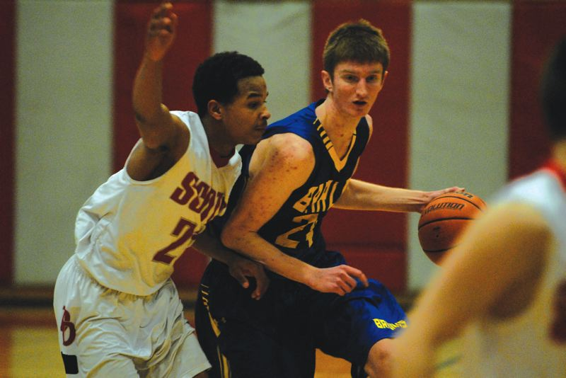 by: THE OUTLOOK: DAVID BALL - Barlows Parker Joncus dribbles around David Douglas defender Charles Jones during the teams 53-51 road win Tuesday night.