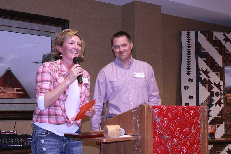by: SUSAN MATHENY/MADRAS PIONEER - JoHanna and Jeremy Symons, of Madras, were honored Feb. 15, as the Jefferson County Livestockmen of the Year.