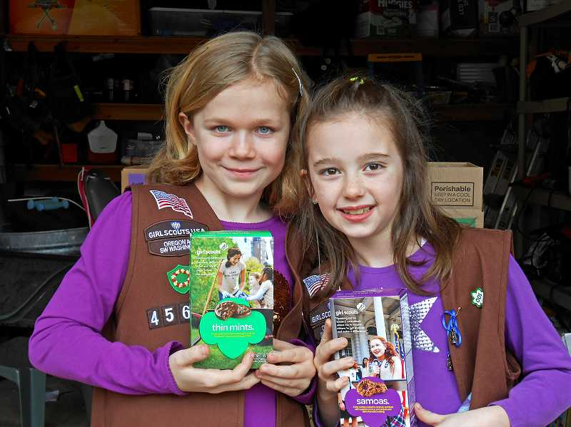 by: TIDINGS PHOTO: KATE HOOTS - Girl Scouts like Beatrice Gilroy, left, and Molly Ruff arent just selling cookies. They want you to vote to name the new TriMet bridge after Abigail Scott Duniway.