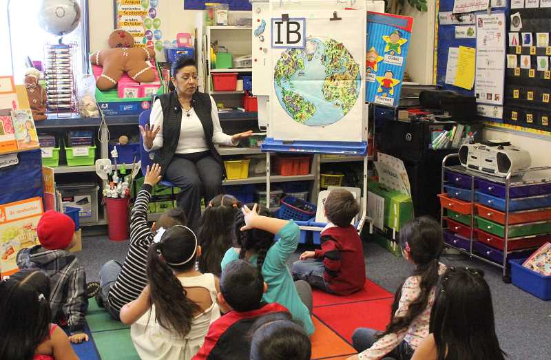 by: LINDSAY KEEFER - Nellie Muir Elementary School kindergarten teacher Rosa Floyd asks her class what IB means last week. Students responded by saying, 'IB means we're special and we're learning about the world.' The school has been named an International Baccalaureate World School after an intensive four-year process.