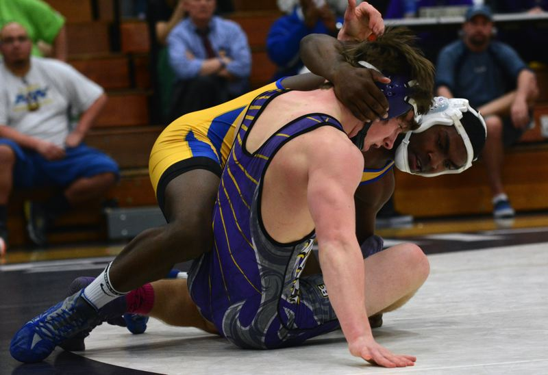 by: TIMES PHOTO: MATT SINGLEDECKER - Aloha 170-pound senior wrestler Maurice McSwain won his match by decision over Sunsets Logan Lachenmeier on Wednesday.