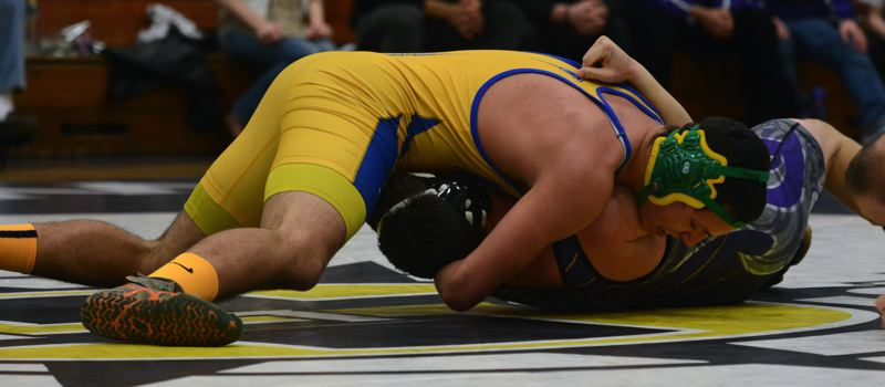 by: TIMES PHOTO: MATT SINGLEDECKER - Aloha 195-pound wrestler Concepcion Rodelo gave the Warriors a chance at team victory, flattening Sunsets Nathan Hartmeier.