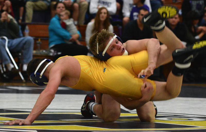 by: TIMES PHOTO: MATT SINGLEDECKER - Sunset 126-pound wrestler Luke Batten won his match by decision against Aloha on Wednesday to help the Apollo clinch the Metro League title.
