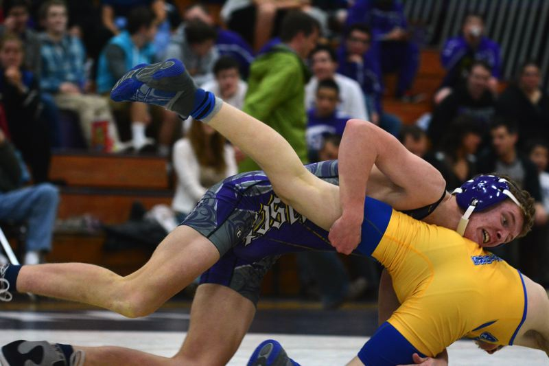 by: TIMES PHOTO: MATT SINGLEDECKER - Sunset 126-pound Grant Bingham goes to work against Aloha's Alex Ashbrook.