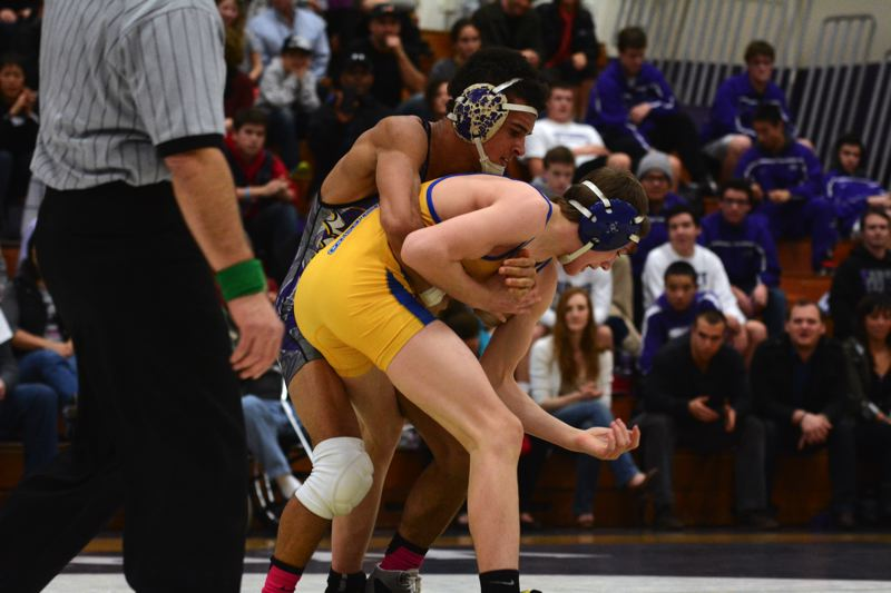 by: TIMES PHOTO: MATT SINGLEDECKER - Sunset 138-pound wrestler Spencer Stokes scored the major decision victory over Aloha on Wednesday.