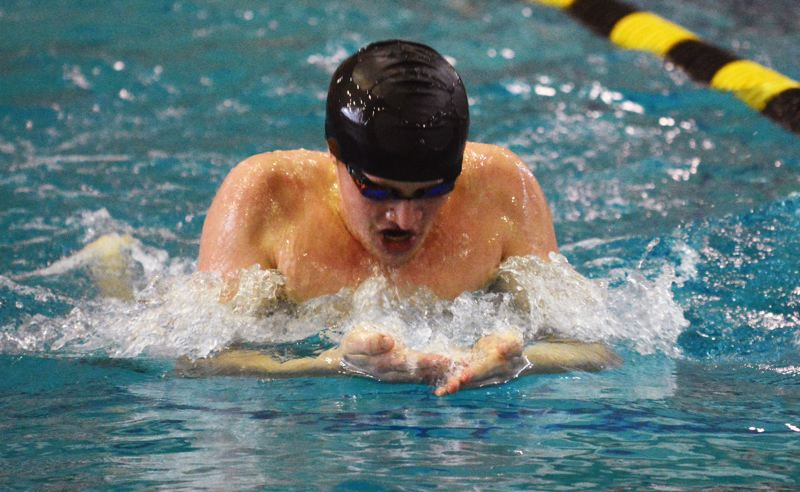 by: TIMES PHOTO: MATT SINGLEDECKER - Southridge junior Patrick Mulcare broke two pool records in the 100 backstroke and 200 IM at the Metro League district meet on Saturday.