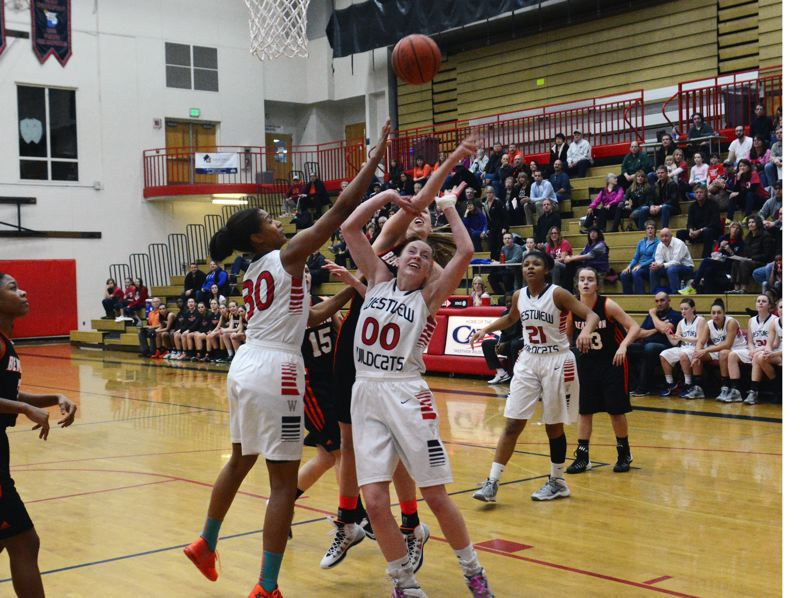 by: TIMES PHOTO: MATT SINGLEDECKER - Westviews Jaime Nared and Dana Bentz battle with Beavertons Dagny McConnell for a defensive board in the first quarter of the Beavers win on Friday.