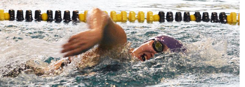 by: TIMES PHOTO: MATT SINGLEDECKER - Sunset girls swimmer Emily Cheng won the 200 free and was part of two winning relays for the Apollos who won districts on Saturday.