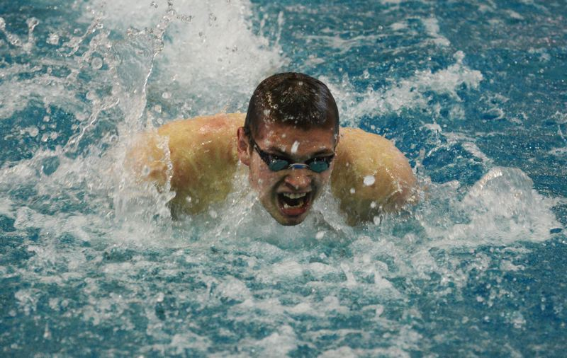 by: TIMES PHOTO: MATT SINGLEDECKER - Sunset boys senior swimmer Johnathan Zoucha took the 100 butterfly, 200 free and helped the Apollo 200 medley and 400 free relay teams win as well.