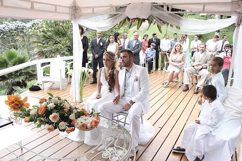 by: SUBMITTED PHOTO - Andrea Marquez Caceres and Carter Gill exchange vows in a ceremony at a residence near Medellin, Colombia.