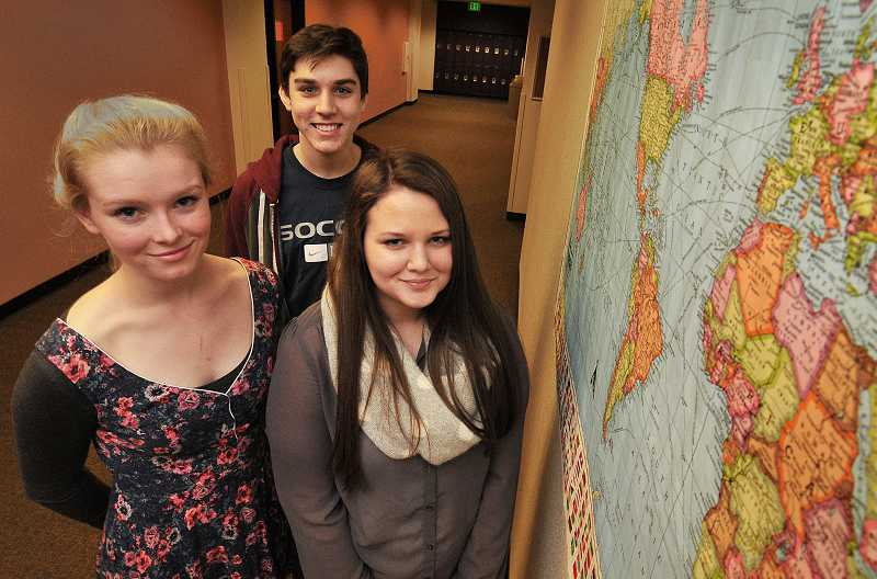 by: REVIEW PHOTO: VERN UYETAKE - Lake Oswego High School planning team and MUN members, from left, Monica Hatfield, Jack McLean and Marissa Taylor are preparing for an upcoming conference in Eugene.