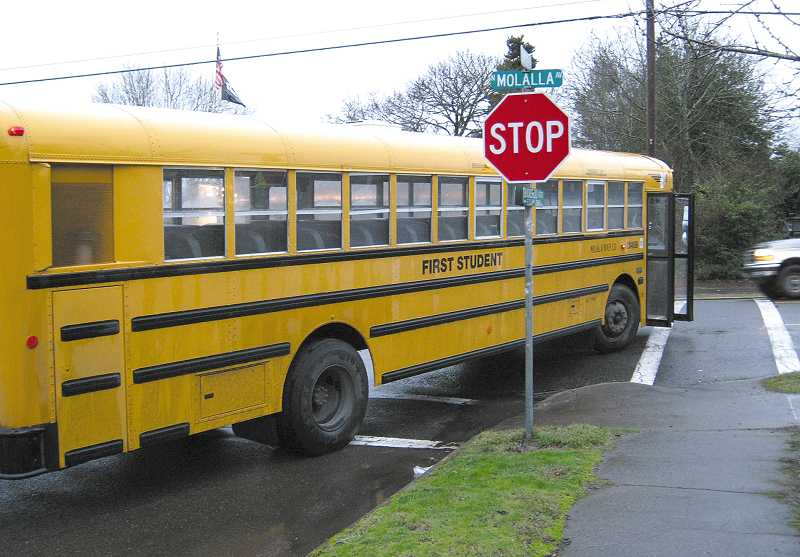 by: MOLALLA POLICE OFFICER CURTIS THORMAN - The driver of this Molalla school bus was cited after the bus rammed into a car on Molalla Avenue last week.