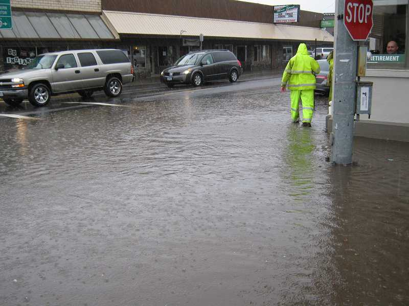 by: MOLALLA POLICE OFFICER CURTIS THORMAN - Flooding went up over the curbs Tuesday at the intersection of Main Street and Molalla Avenue in Molalla.