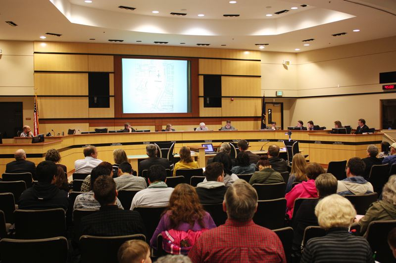 by: HILLSBORO TRIBUNE PHOTO: DOUG BURKHARDT - In a marathon public session that stretched over six hours, the Hillsboro Planning Commission reviewed the developers changes to the proposed Sequoia Village project and heard from numerous citizens, almost all of whom opposed the project.