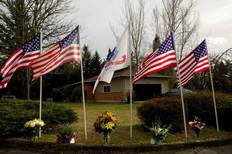 by: TIMES PHOTO: JAIME VALDEZ - Flags fly at the Cedar Hills residence, where John Alexander Pelham grew up in Beaverton.